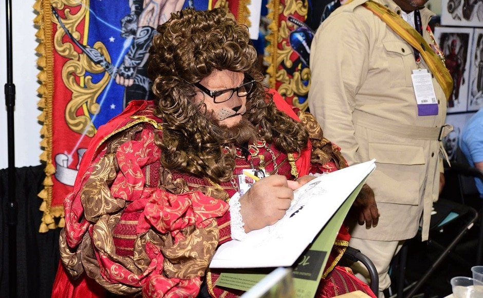 A cosplayer dressed as The Beast draws a sketch. Image from Facebook