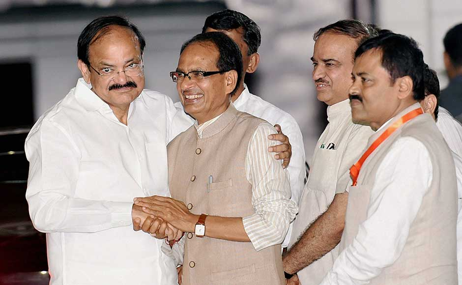 The 68-year-old leader currently holds the two portfolios of Information and Broadcasting and Housing and Urban Affairs. His nomination is seen as part of the saffron party's attempts to expand in south India. Naidu is greeted by MP Chief Minister Shivraj Chauhan and other leaders after the meet. PTI