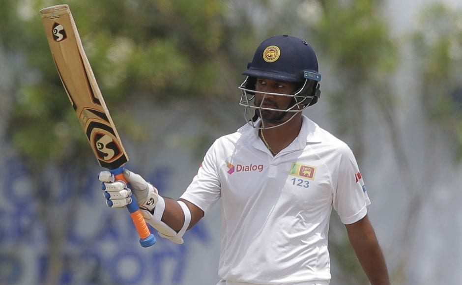 Dimuth Karunaratne battled on with a half century but after his departure in the final session their hopes sank in Galle. AP