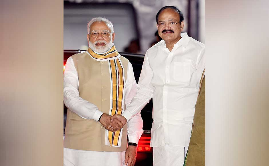 Naidu is greeted by Narendra Modi after he was announced as the NDA vice-presidential candidate. PTI