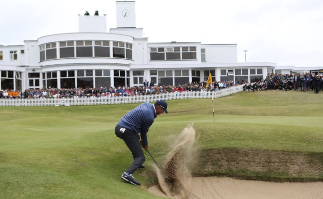Matt Kuchar plays out of the bunker on the 18th hole during the final round of the British Open. The 39-year-old, who has never won a major, had played solid and consistent golf throughout the week but fell short at the end. AP (AP Photo/Peter Morrison)
