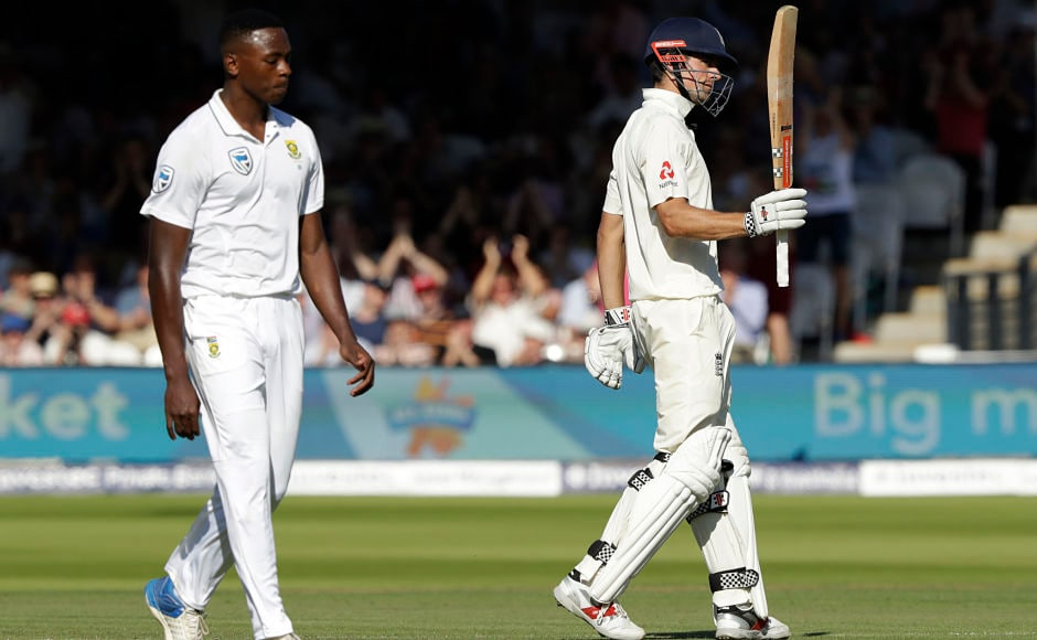 England's Alastair Cook celebrates reaching 50 runs next to South Africa's Kagiso Rabada who was bowling during the first test between England and South Africa at Lord's cricket ground. AP