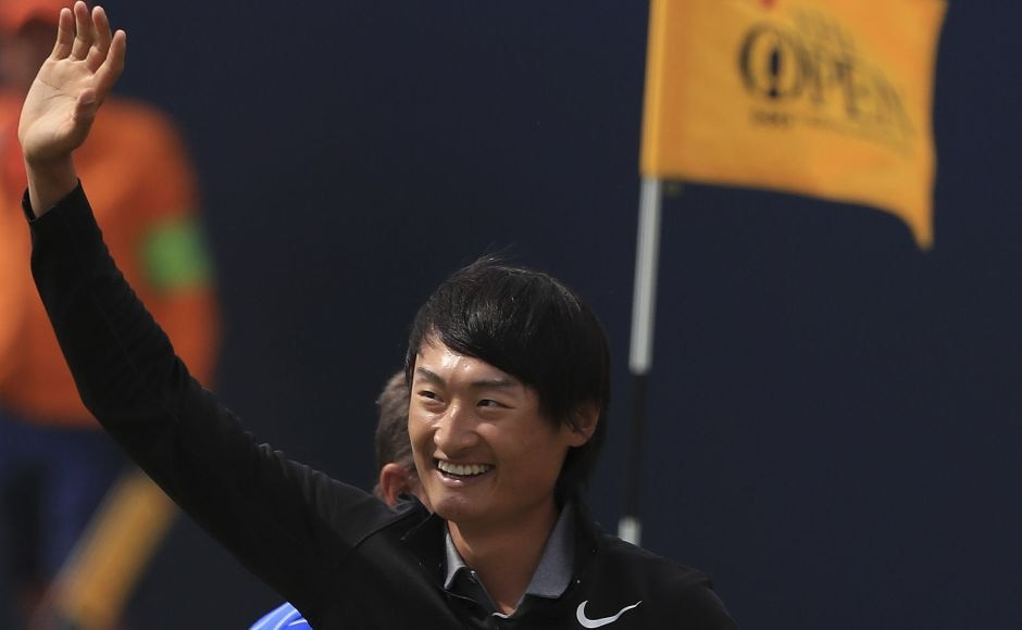 China's Li Haotong celebrates on the 18th during the final round of the British Open. The 21-year-old golfer became the fourth player to shoot 63 in the final round of the British Open. AP