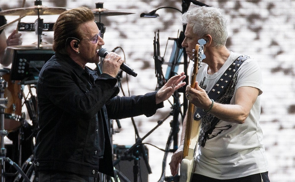 Singer Bono of the band U2, left, performs on stage with Adam Clayton. Photo by AP