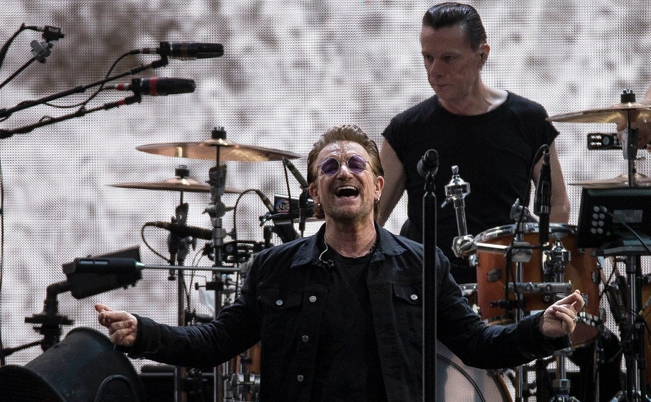 Singer Bono of the band U2 performs. Photo by AP