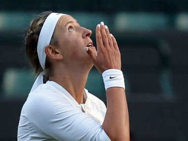 Victoria Azarenka of Belarus celebrates after winning her Women's Singles Match against CiCi Bellis of the United States, on the opening day at the Wimbledon Tennis Championships in London Monday, July 3, 2017. (AP Photo/Tim Ireland)