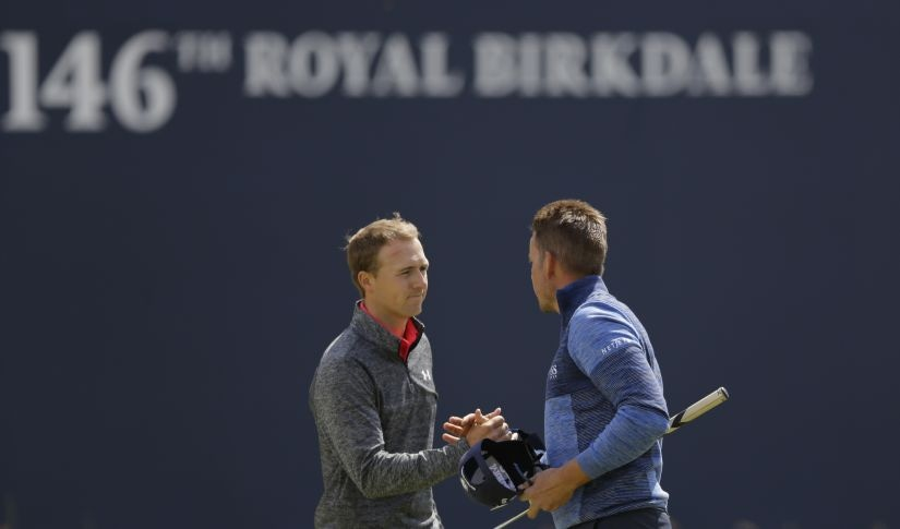 Jordan Spieth and Henrik Stenson shake hands after finishing their round on the first day of the British Open. AP