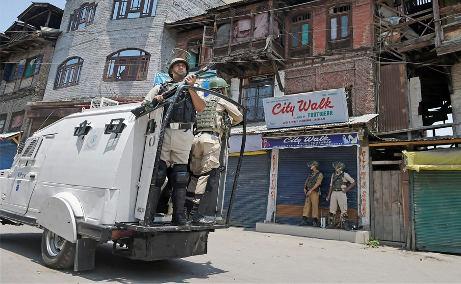 Security personnel patrolling the city during a curfew imposed in Srinagar. Curbs on the assembly of people under Section 144 CrPc had been imposed in Pulwama and Shopian districts in south Kashmir and in Baramulla district in north, officials said. PTI