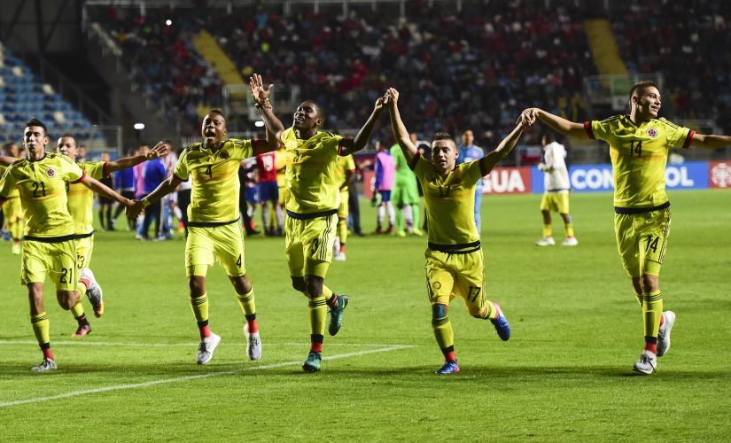Colombia's players celebrate their victory over Paraguay during the South American U-17 tournament. AFP