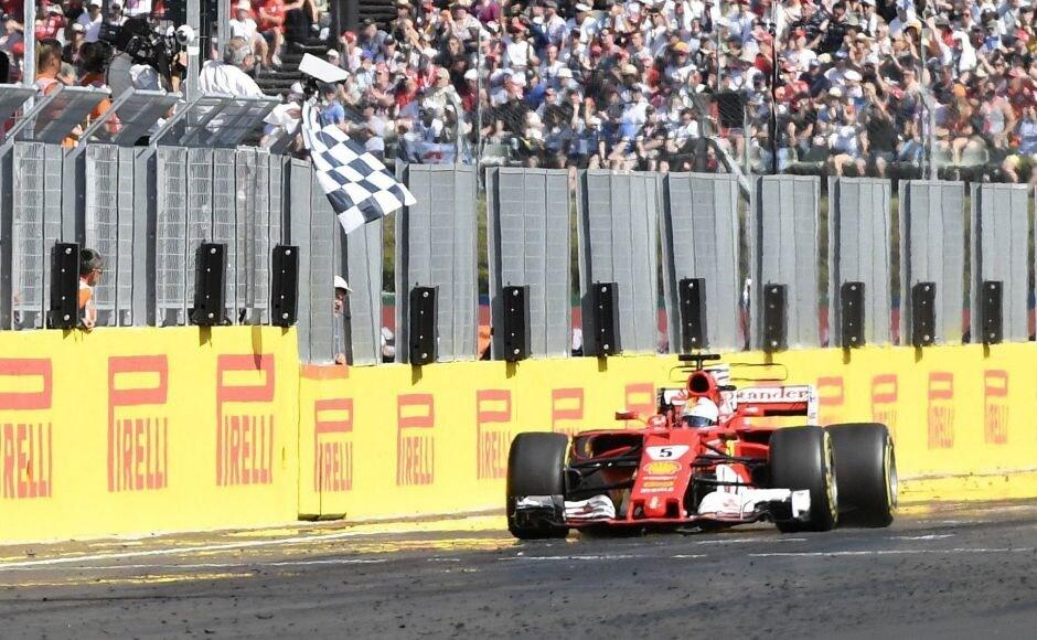 Vettel held on for his 46th career win, while Raikkonen expertly defended his position for a Ferrari 1-2. AP