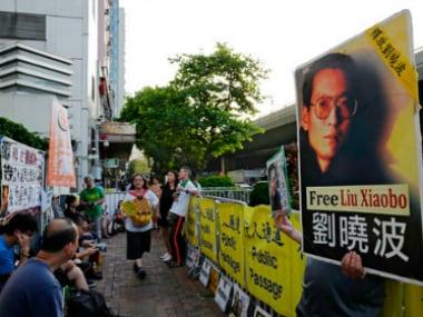 Protesters display portrait of Chinese Nobel Peace laureate Liu Xiaobo. AP