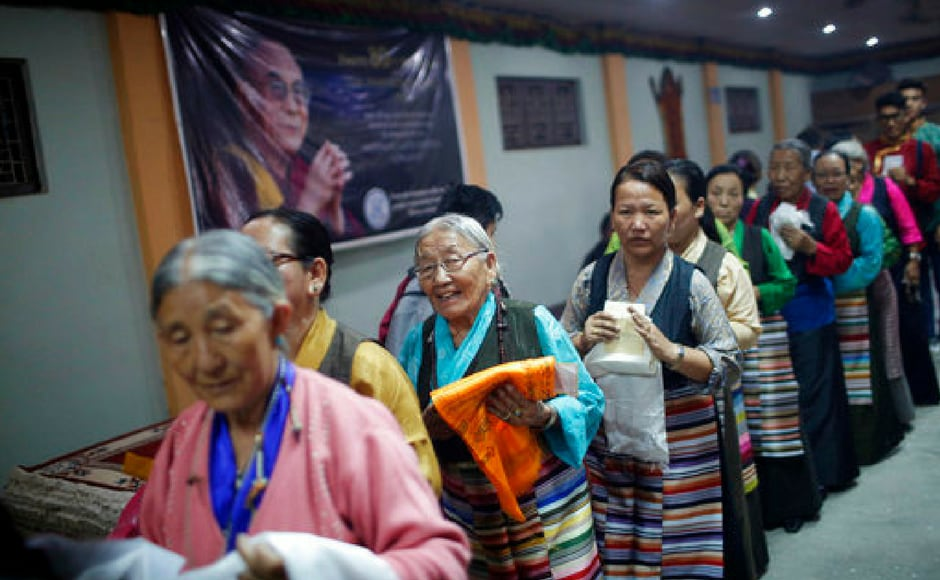 Old women queue up to offer prayers to the Dalai Lama in Lalitpur of Nepal on Thursday. AP