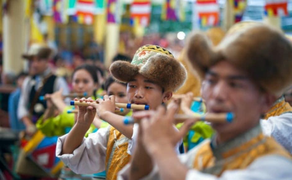 Performers at Dalai Lama's birthday celebrations in Dharamsala on Thursday. AP