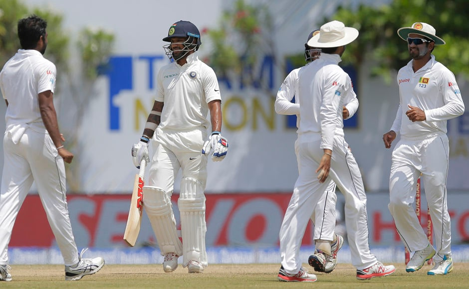 India's Shikhar Dhawan, second leaves the pitch after being dismissed by Sri Lanka's Dilruwan Perera. AP