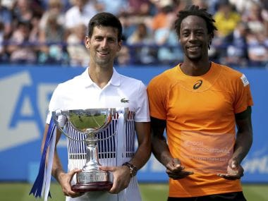 Serbia's Novak Djokovic celebrates with the trophy after defeating France's Gael Monfils in the men's singles final at the AEGON International tennis tournament at Devonshire Park, Eastbourne, England, Saturday, July 1, 2017. (Steven Paston/PA via AP)