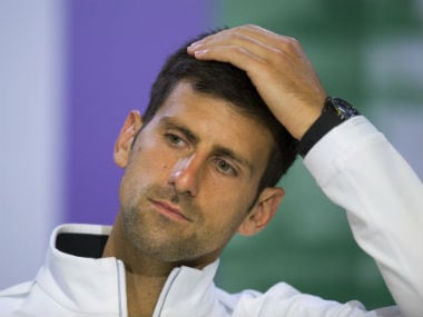Novak Djokovic  during a press conference after losing his Men's Singles Quarterfinal Match against Czech Republic's Tomas Berdych on day nine at the Wimbledon Tenn. AP