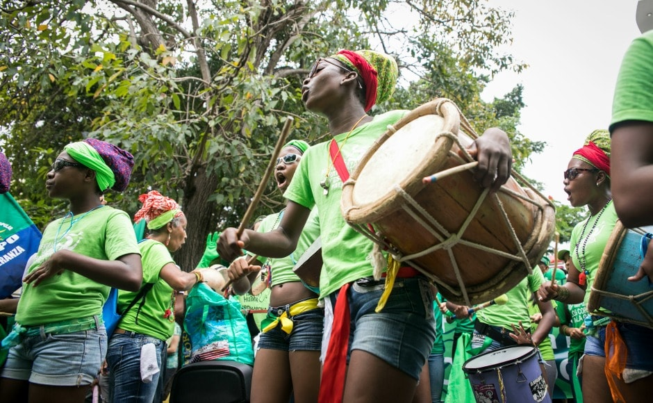 An Afro-Dominican dance troupe performs during the Green Movement's march, created to protest against corruption and demand an independent body for investigation on the scandal, in Santo Domingo. This protest is being termed as the mother of all marches. AP