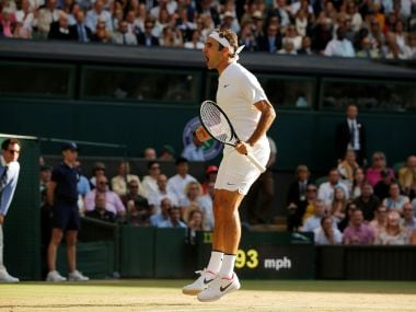 Roger Federer celebrates winning the quarter-final match against Milos Raonic. Reuters
