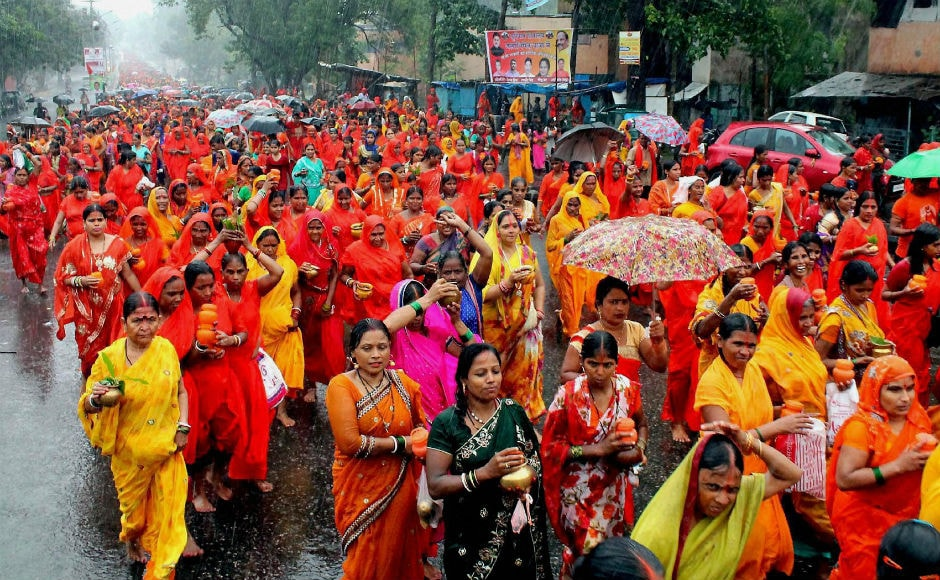 In Jamshedpur, Hindu devotees carried water in urn to offer it to lord Shiva. PTI