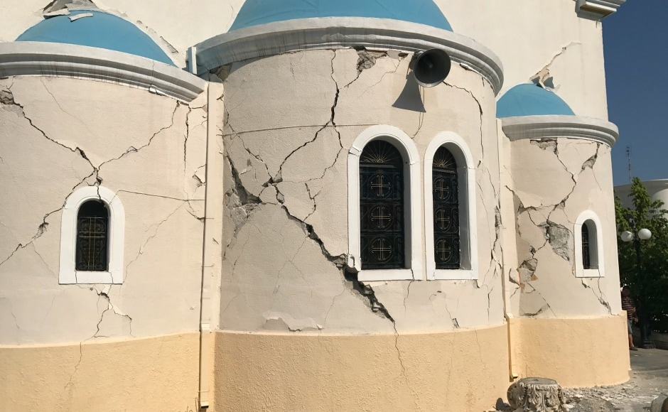 Reports said several buildings were evacuated after cracks appeared. AP