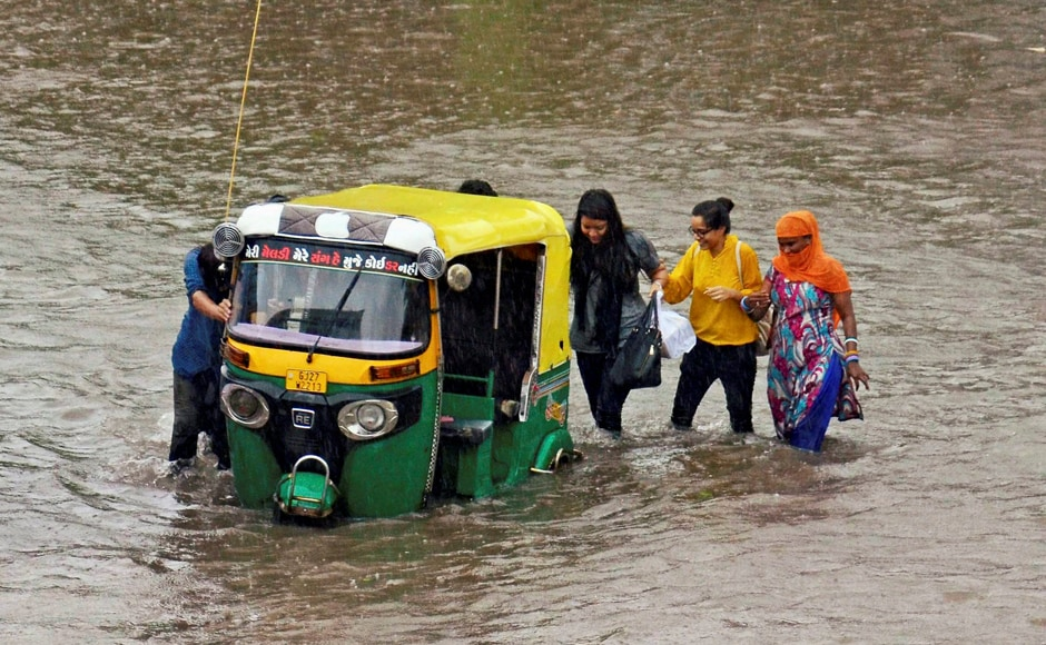 The Ahmedabad Municipal Corporation issued a warning to people not to venture near electricity poles and streetlights as it may prove fatal due to the water-logging. PTI
