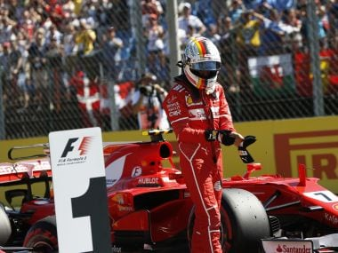 Ferrari's Sebastian Vettel walks away from his car after clocking the fastest time during the qualifying session on Saturday. AP