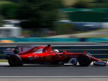 Ferrari driver Sebastian Vettel steers his car during the third free practice session for the Hungarian Formula One Grand Prix. AP