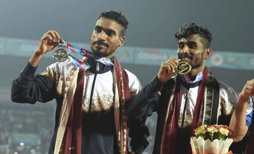 Gopi Thonakal (L) and G Lakshmanan (R) pose with thier silver and gold medals after men's 10,000m event. PTI