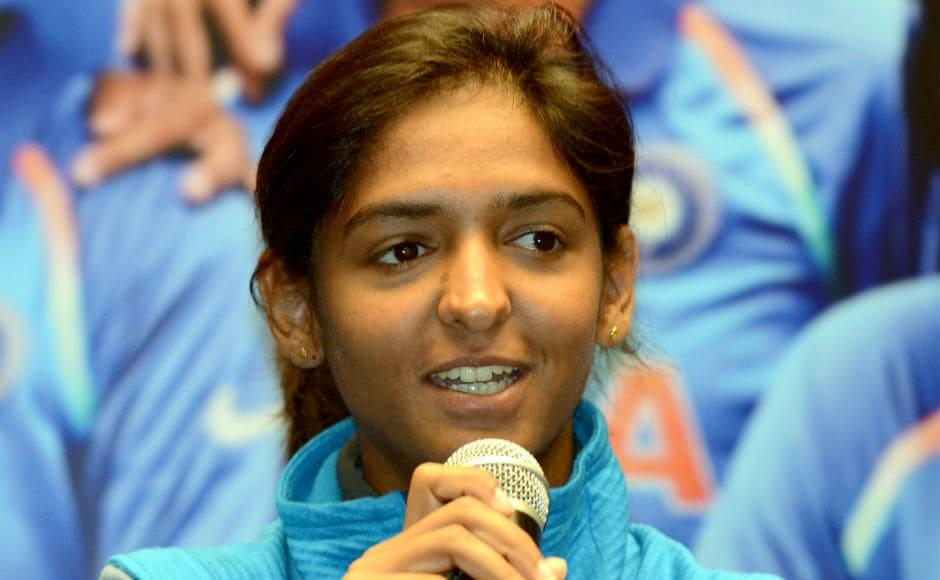Harmanpreet Kaur happily addresses the media after returning from England. AFP