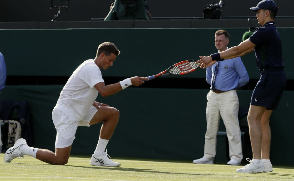 Canada's Vasek Pospisil falls after playing a shot on day two of the Wimbledon. AP