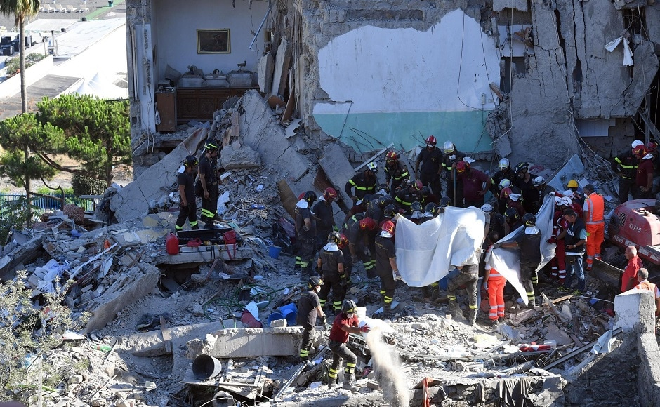 The firefighters and police on Saturday pulled the eighth and final body from the rubble of the building. About 80 firefighters worked with the police through the night. AP
