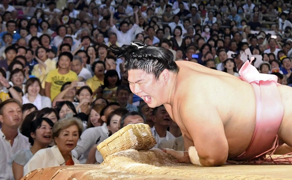 In Japan, sumo wrestling has been a tradition for centuries. In the sport, a sumo wrestler attempts to force another wrestler either out of the ring, or to touch the ground with any part of the body except the soles of their feet. AP