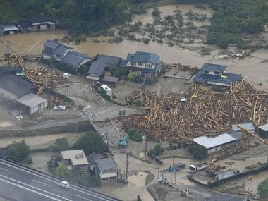 Thousands to be evacuated in Japan as heavy rain causes major flooding in Akita prefecture