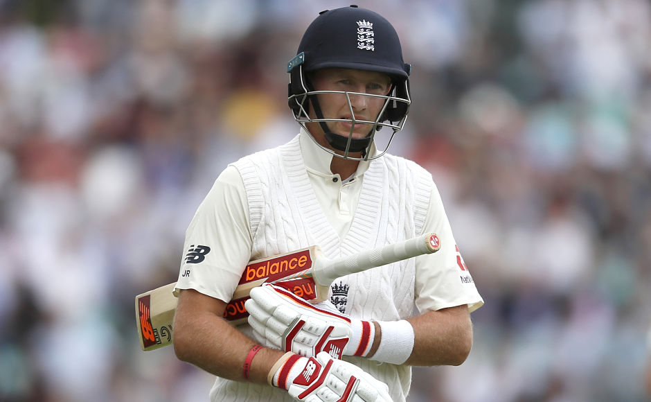 England's Joe Root leaves the pitch after being caught by South Africa's Quinton de Kock, who dived to his right and took a one-handed catch. AP