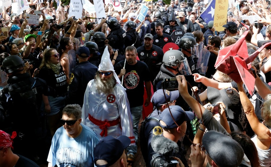Supporters of white supremacist group Ku Klux Klan marched in Charlottesville, Virginia on Saturday to protest the planned removal of a statue of General Robert E Lee, who oversaw Confederate forces in the US Civil War. Reuters