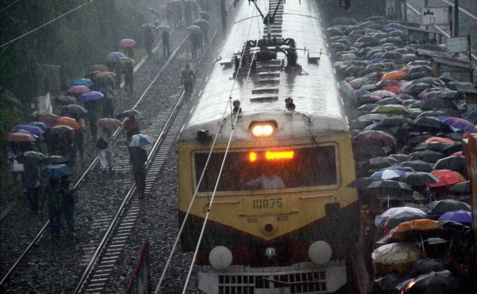 Heavy rains lashed the southern and western districts of West Bengal on Saturday, swelling several rivers, and delaying local and inter-city trains. PTI