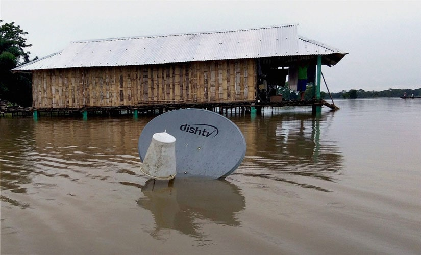 A scene of a submerged house as many areas in Assam have been inundated by waters following incessant rains in the state, at Narayanpur in Lakhimpur on Wednesday. PTI