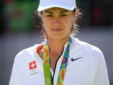 2016 Rio Olympics - Tennis - Victory Ceremony - Women's Doubles Victory Ceremony - Olympic Tennis Centre - Rio de Janeiro, Brazil - 14/08/2016. Silver medalist Martina Hingis (SUI) of Switzerland reacts after receiving her medal.  REUTERS/Toby Melville  FOR EDITORIAL USE ONLY. NOT FOR SALE FOR MARKETING OR ADVERTISING CAMPAIGNS.   - RTX2KRDW