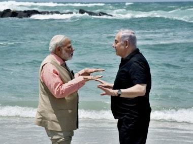 Narendra Modi and Benjamin Netanyahu at Olga Beach on Thursday. PTI