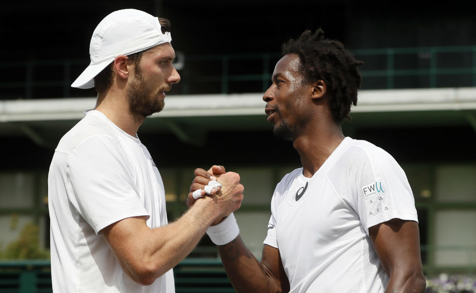 Gael Monfils shakes hands with Germany's Daniel Brands after beating him in their men's singles match on day two. AP