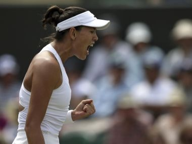 Spain's Garbine Muguruza celebrates winning the second set against Germany's Angelique Kerber during their Women's Singles Match on day seven at the Wimbledon Tennis Championships in London Monday, July 10, 2017. (AP Photo/Tim Ireland)