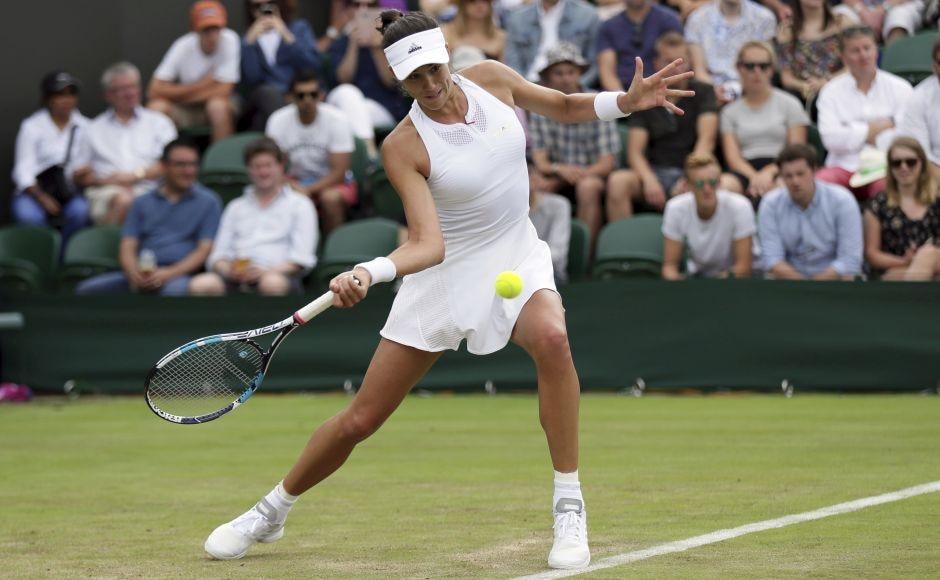 2015 finalist Garbine Muguruza breezed through the first round of Wimbledon after a straight-sets victory against Ekaterina Alexandrova. AP