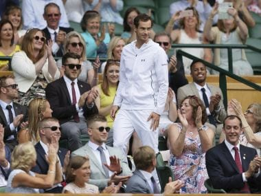 Andy Murray takes his seat on center court on day six at Wimbledon. AP