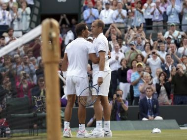 Gilles Muller, right, with Rafael Nadal after winning their fourth round match. AP