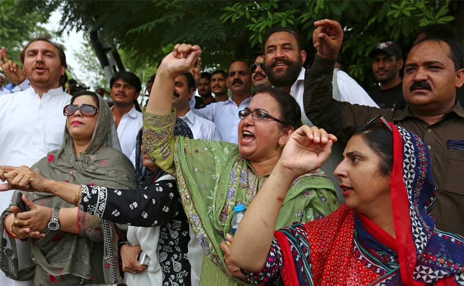 Supporters of Nawaz Sharif's Pakistani ruling party Pakistan Muslim League (N) (PML-N) shout slogans in favour of their leader at the Supreme Court in Islamabad. Nawaz Sharif's daughter Maryam asserted that her father's disqualification by the Supreme Court would not deter him from staging a comeback. AP