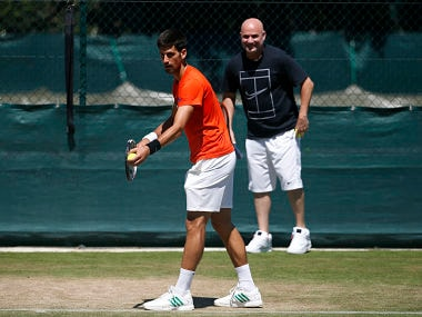 Serbia's Novak Djokovic in a training session with coach Andre Agassi. AP