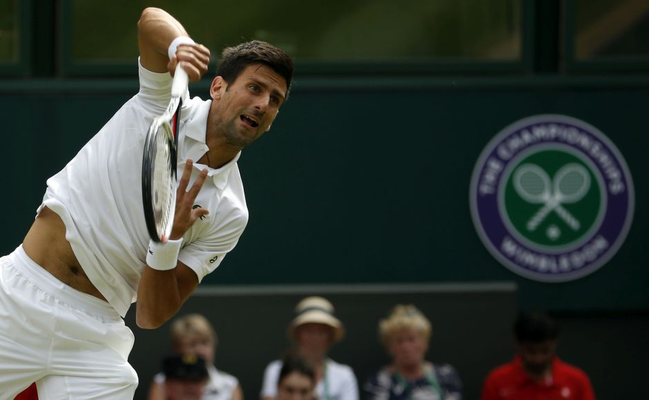 Novak Djokovic advanced to the second round at Wimbledon after just 40 minutes when his opponent, Martin Klizan, retired because of an injury while trailing 6-3, 2-0. AP