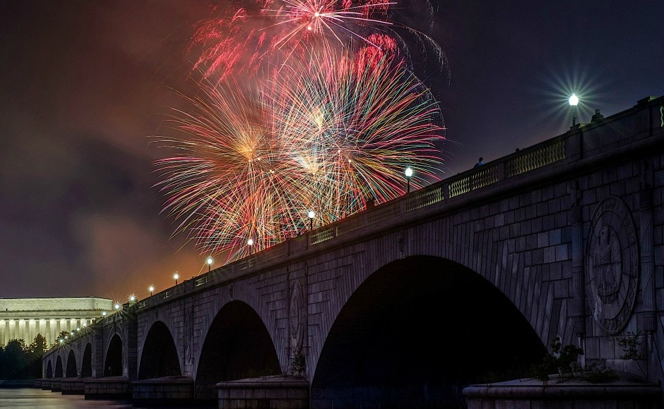 From flashy firework displays for massive crowds to small-town parades, Americans celebrated the United States' 241st birthday in both joyous and serious ways. AP