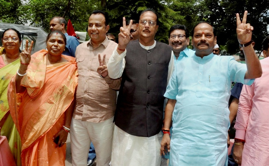 Jharkhand chief minister Raghubar Das along with BJP MLAs flashes the victory sign after casting their vote at Jharkhand Assembly. After the elections, all the ballot boxes from all the state capitals and will be brought to New Delhi for the final counting on 20 July. PTI