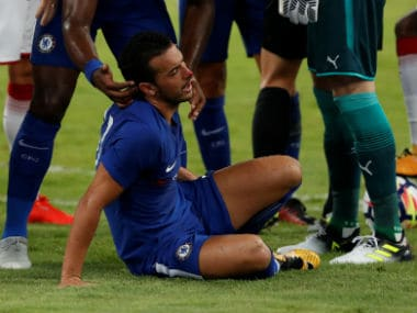 Chelsea's Pedro receives medical attention after colliding with Arsenal's David Ospina. Reuters